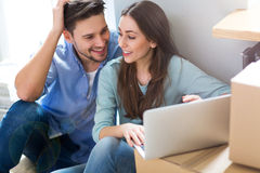 Couple with unpacked boxes in new home Royalty Free Stock Photography