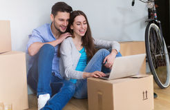 Couple with unpacked boxes in new home Royalty Free Stock Images