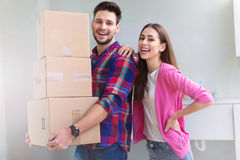 Couple with unpacked boxes in new home Stock Image