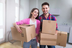 Couple with unpacked boxes in new home Royalty Free Stock Photos