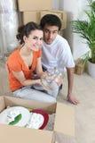 Couple unpacking Stock Photo