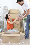 Couple unpacking belongings Royalty Free Stock Photography