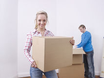 Couple unpacking boxes Royalty Free Stock Images