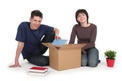 Couple Unpacking Boxes stock photography