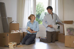 Couple Unpacking Boxes At Home stock images