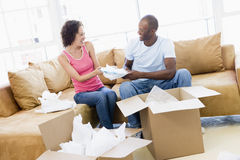 Couple unpacking boxes in new home Royalty Free Stock Photo