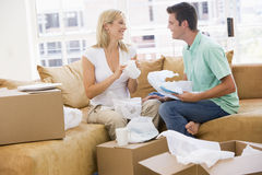 Couple unpacking boxes in new home smiling Royalty Free Stock Photo