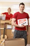 Couple unpacking boxes in new house Stock Photo