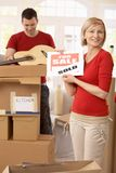 Couple unpacking boxes in new house Stock Photography