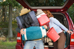 Couple unpacking car Stock Images