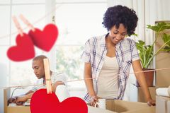 Couple unpacking cardboard boxes Royalty Free Stock Photography