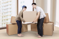 Couple unpacking cardboard in new home 1 Royalty Free Stock Photo