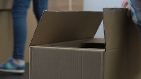 Couple unpacking cartons, decision to live together, new stage in relations. Stock footage stock footage