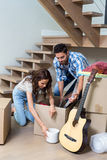 Couple unpacking computer from cardboard box Royalty Free Stock Photos