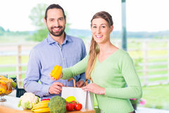 Couple unpacking grocery shopping bag at home Royalty Free Stock Image