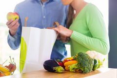 Couple unpacking grocery shopping bag at home Royalty Free Stock Photo