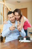 Couple unpacking new compact digital camera Stock Photo