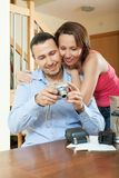 Couple unpacking new compact digital camera Royalty Free Stock Image