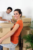 Couple unpacking their belongings Royalty Free Stock Photo