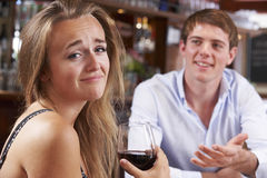 Couple On Unsuccessful Blind Date In Restaurant Royalty Free Stock Images