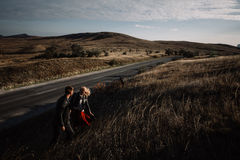 Couple up the hill holding hands. Royalty Free Stock Images