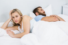 Couple upset after having a fight on bed stock image