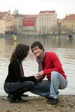 Couple on urban riverfront. Young, smiling couple on urban riverfront Stock Photo