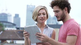 Couple In Urban Setting With Digital Tablet Taking Photo Stock Images