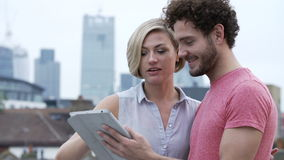 Couple In Urban Setting With Digital Tablet Taking Photo Royalty Free Stock Photos