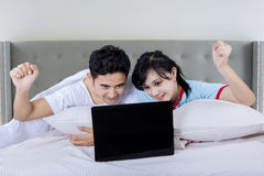 Couple use laptop on bedroom Royalty Free Stock Photo
