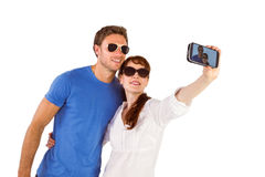 Couple using camera for picture Royalty Free Stock Photography