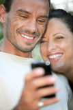 Couple using a cameraphone Royalty Free Stock Images
