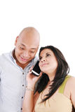 Couple using cell phone Stock Image