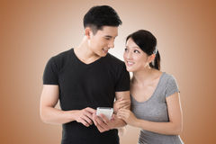 Couple using cellphone Royalty Free Stock Photography