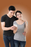 Couple using cellphone Royalty Free Stock Image