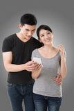 Couple using cellphone Stock Images