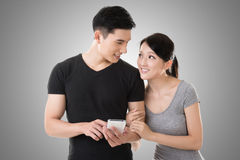 Couple using cellphone Royalty Free Stock Photos