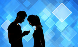 Couple using cellphone Stock Photography