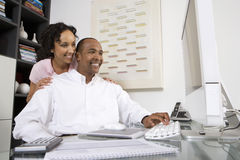 Couple Using A Computer Stock Image