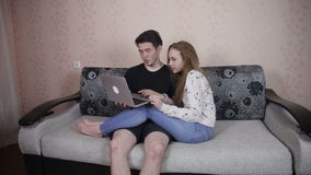 Couple using computer at home. Family, technology concept. stock footage
