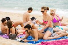 Couple using cream for sunburn Stock Image