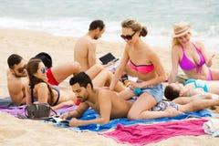 Couple using cream for sunburn Royalty Free Stock Photography