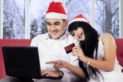 Couple using credit card for paying online Stock Image
