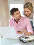 Couple using credit card shopping. Couple using credit card to shop online Stock Photography