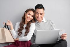 Couple using credit card to shop online stock image