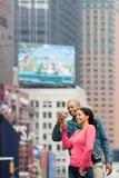 Couple using digital camera Royalty Free Stock Photo