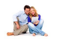 Couple using digital tablet. In white background Royalty Free Stock Images