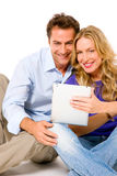 Couple using digital tablet Royalty Free Stock Photos