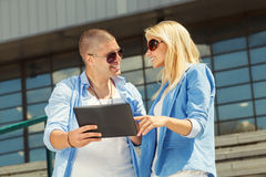 Couple using a digital tablet Royalty Free Stock Photos