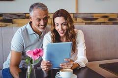 Couple using digital tablet Stock Photos